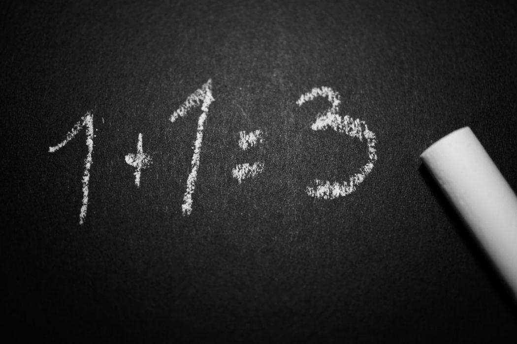 A blackboard with 1+1 = 3 written in chalk