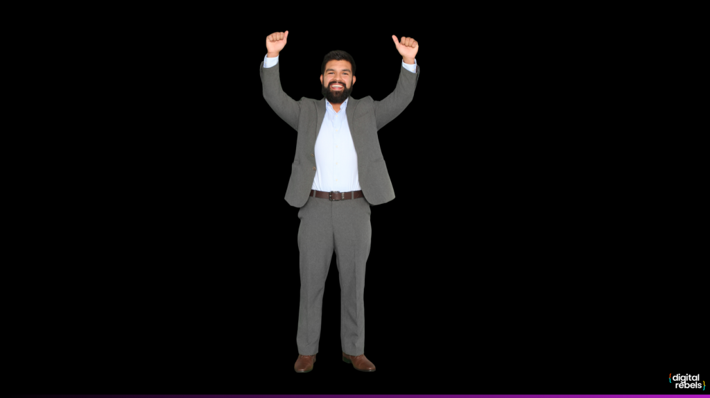 A man in a suit giving two thumbs up and smiling